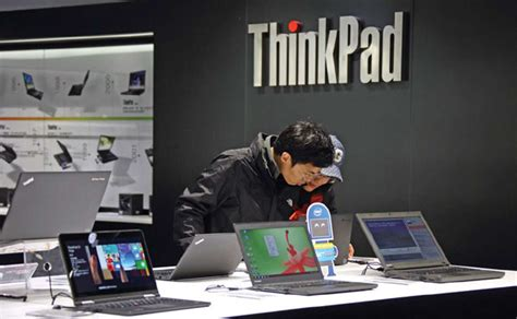 customers try out laptop computers at a lenovo outlet in