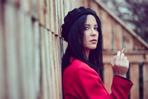 Beautiful French Woman With Beret And Red Coat How Smoking