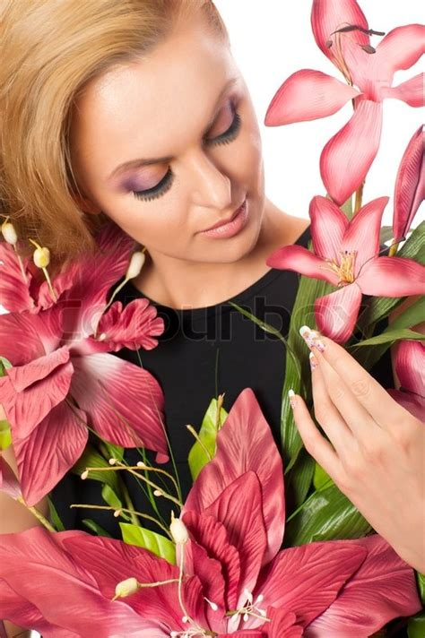 Portrait of young beautiful woman holding flowers isolated